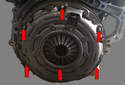 To remove the clutch, remove six E10 Torx bolts from pressure plate (red arrows).
