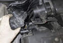 Once you have removed the throttle body fasteners and electrical connector, remove the throttle body from the engine.