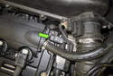 Intake camshaft sensor: Locate the sensor (green arrow).