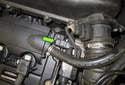 Intake camshaft sensor: Locate the sensor (green arrow).