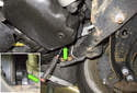 Install a 18mm socket and ratchet (green arrows) on the crankshaft pulley bolt.