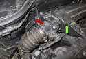 The mass airflow sensor (red arrow) is located at the air filter-housing (green arrow) outlet, on the right side of the engine.