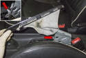 Pull the parking brake handle trim up and over the handle.