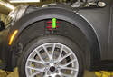 Front trim: The wheel well arch trim (green arrow) is one piece, wrapping around the fender, connecting the bumper trim and the lower body trim.