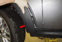Front trim: Next, pull the wheel well arch trim away from the fender and at the bottom and remove it.