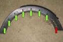 Front trim: This photo shows the locations of all seven of the wheel well arch trim clips (green arrows).