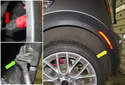 Rear trim: Starting at the rear lower corner of the wheel well liner (yellow arrow), peel it back to expose the side marker light electrical connector (red arrow) and the wheel well arch trim expanding rivet (green arrow).