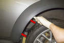 Rear trim: Next, pull the wheel well arch trim away from the fender and at the bottom and remove it.