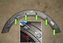 Rear trim: This photo shows the locations of all five of the wheel well arch trim clips (green arrows).