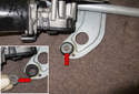 This photo shows the 13mm fastener bushing with washer (red arrows).