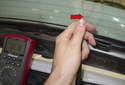 To test for a break or high resistance in the window grid, connect one lead of your DVOM to one of the antenna amplifier connectors.