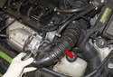 Detach and remove the intake duct (red arrow) from the intake air housing and turbocharger.