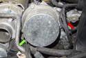Next, remove the vacuum pump fasteners.