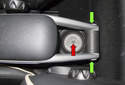 If your vehicle has the optional armrest, start by removing the T15 Torx screw in the rear cup holder (red arrow).