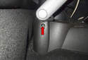 This photo shows the screw located at the side of the armrest (red arrow).