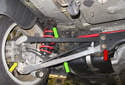 The upper control arm is located on each side in the same position (top green arrow).