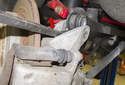 Upper control arm: Using a pry bar (red arrow), lever the control arm out of the trailing arm.