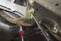 Lower control arm: Next, remove the subframe bolt.