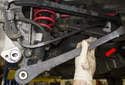Lower control arm: Remove the control arm from the vehicle (red arrow).