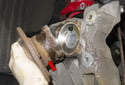 Next, remove the wheel bearing (red arrow) from the trailing arm.