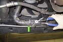 Draining cooling system: For turbocharged models (Cooper S), you will have to remove the left side radiator hose (green arrow) to drain the coolant.