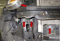 Working at the bumper support, remove the three 13mm support fasteners (red arrows).