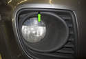 To adjust the fog light beam angle, use a long 4mm Allen through the access hole (green arrow).