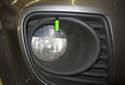 To adjust the fog light beam angle, use a long 4mm Allen through the access hole (green arrow).