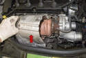 Remove the turbocharger heat shield (red arrow).