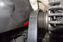 Remove the drive belt from the alternator pulley (red arrow).