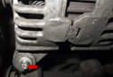 Remove the lower E10 external Torx (red arrow) alternator fastener.