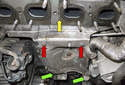 To replace the oil lines and the exhaust manifold gasket (yellow arrow), start by removing the heat shield.
