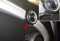 Working at the inner door handle, remove the plastic rivet (red arrow).