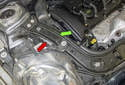 The right engine mount (red arrow) is right below the radiator support (green arrow).