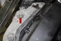 Remove the 18mm engine mount nut (red arrow).