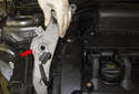 Then remove the engine mount support bracket from the engine (red arrow).