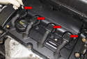 Open all four ignition coil electrical connectors by rotating the connector (red arrows) up 90°.