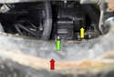 Working below the engine, through the opening in the sub frame (red arrow), remove the 10mm support bracket fastener (green arrow).