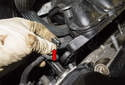 Slide the intake manifold away from the cylinder head just enough to access the wiring harness at the right side.