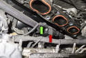 Slide the intake manifold away from the cylinder head until you can see the purge solenoid (red arrow).