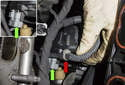 Working at the left side of the intake, detach the wiring harness (red arrow) by pulling the clip out.