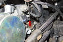 Then disconnect the coolant temperature sensor connector (red arrow).