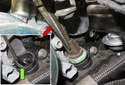 Coolant sensor: Using pliers, pull the sensor out of the thermostat (red arrow).
