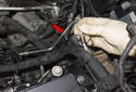 Remove the fuel line (red arrow) and throw it away.