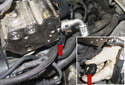 Remove the fuel pump electrical connector (red arrow).