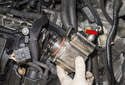Slide the fuel pump out of the cylinder head to remove (red arrow).