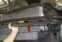 Hold the bumper support in place when removing the final fastener.