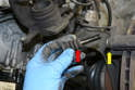 Now is a good time to remove the guide bolts and check the condition of the rubber protective boot (red arrow) and the condition of the lubricant on the bolt.