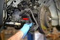 Remove the caliper-mounting bracket (red arrow).