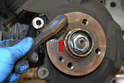 Use a wire brush and give the hub flange a good cleaning.